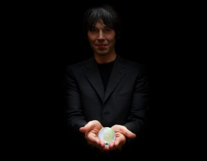 Brian Cox with a globe